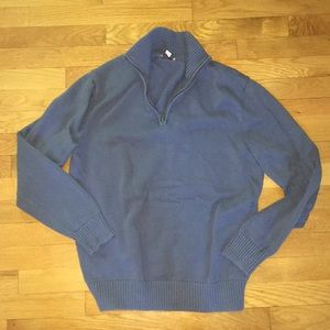 Blue quarter-zip sweater.